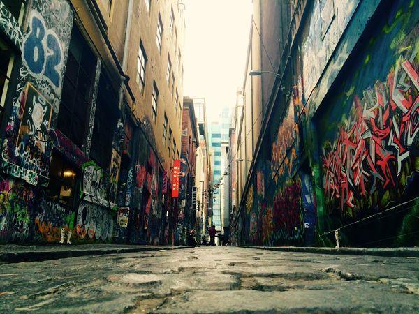 The vibrant back street of Melbourne City Narrow City Life Vanishing Point