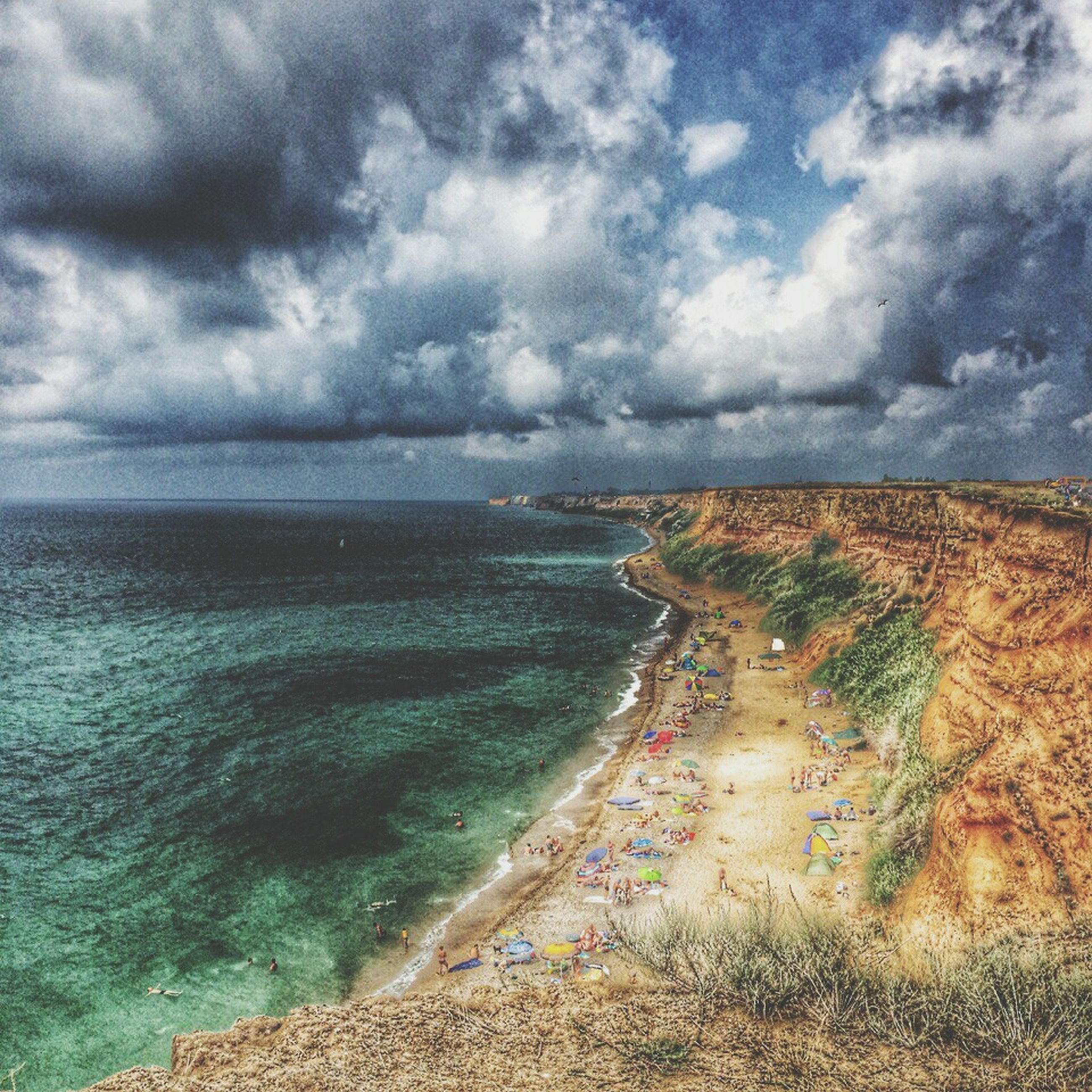 sea, water, horizon over water, sky, beach, scenics, cloud - sky, beauty in nature, tranquil scene, tranquility, shore, cloudy, nature, coastline, sand, cloud, idyllic, wave, surf, outdoors