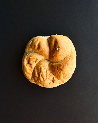 High angle view of bread on table against black background