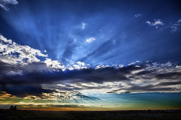 Landscape against cloudy sky
