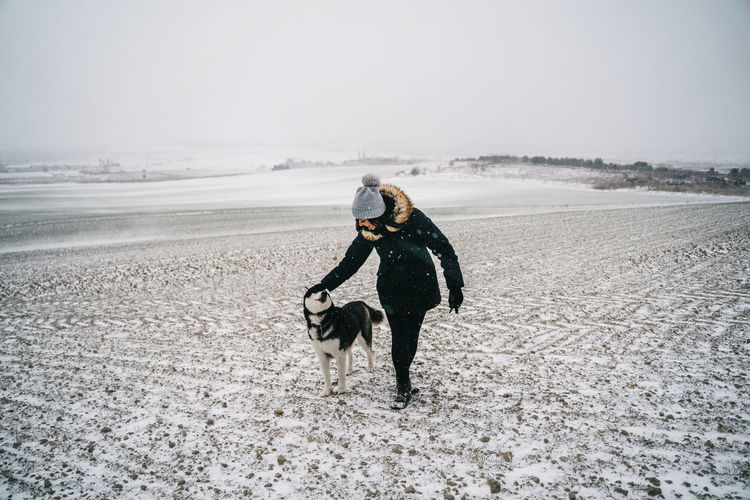 Man with dog on snow