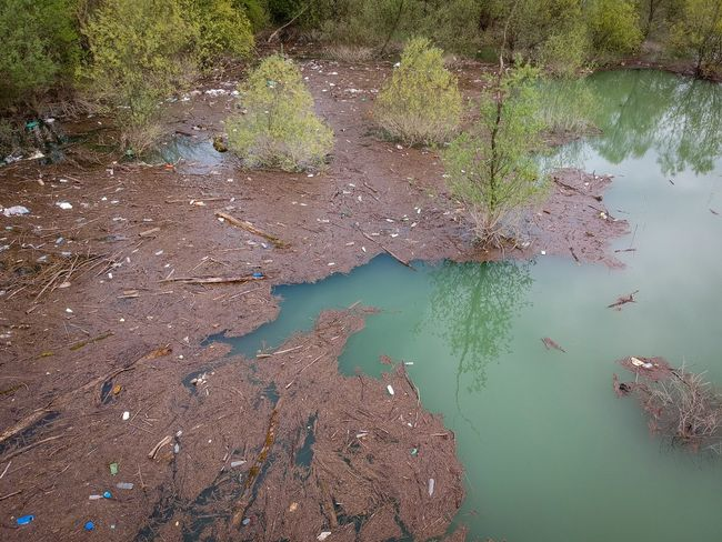 Plastic bags in a river Plastic Aerial Dji River Dirt Trash Water High Angle View Nature Day Beauty In Nature Scenics - Nature Aerial View No People Outdoors Plant Land Tree Beach End Plastic Pollution