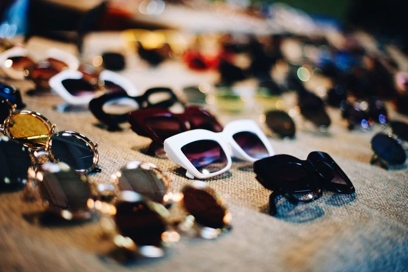 sunglasses Still Life Choice Indoors  Close-up No People Variation Table Art And Craft Focus On Foreground Group Of Objects Personal Accessory High Angle View Large Group Of Objects Sunglasses Selective Focus Multi Colored Fashion Jewelry Glasses Creativity