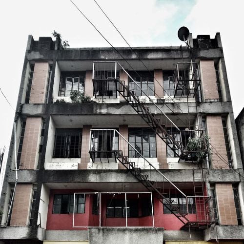 Apartment Architecture Building Exterior Built Structure Fire Escape Window Staircase Steps And Staircases Low Angle View Safety Urgency Steps Damaged Outdoors Day Residential Building No People Sky