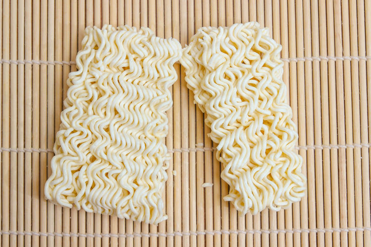 High angle view of noodles on wood