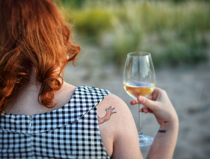 Redhead girl with cute fox tattoo drinking wine outdoors Fox Tattoo Cute Tattoo Tattoo Redhead Redhead Girl Girl With Wine Golden Hour Wine Outdoors Wine By The Sea Girl By The Sea Cartoon Tattoo Winetasting Wineglass Women Young Women Alcohol Human Hand Drink Wine Summer Holding White Wine Alcoholic Drink Sommelier