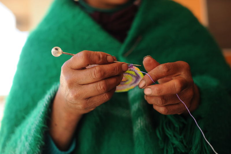Midsection Of Person Knitting Wool