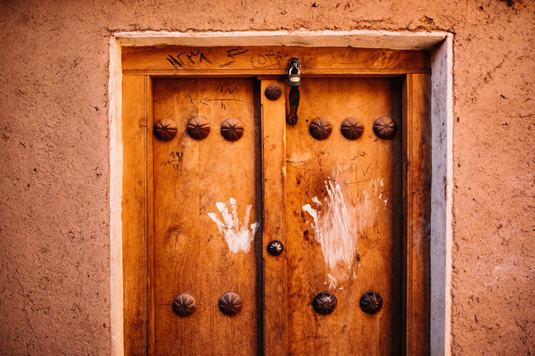let me in Abyaneh, Iran Hands Kashan Red Village Archaeological Sites Architecture Brown Closed Door Entrance Historical Place History House Irantravel Lock Old Persia Protection Reddish Safety Traditional Wood - Material