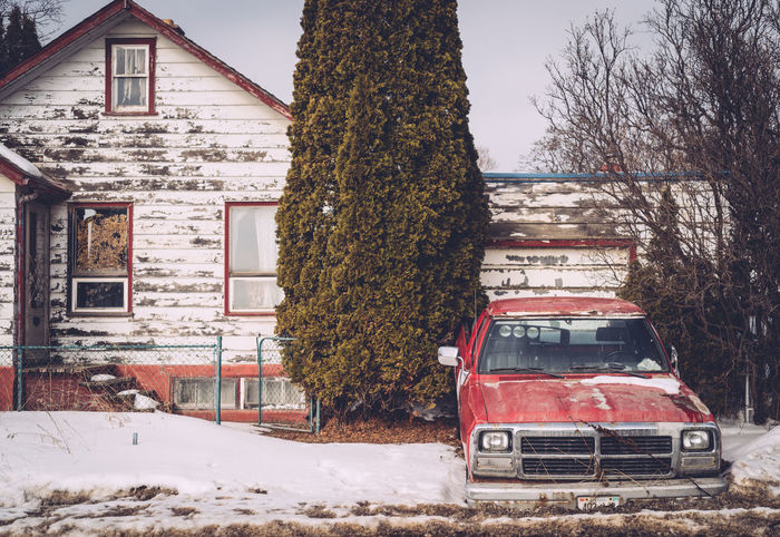 Architecture Building Exterior Built Structure Cold Temperature Day Front Yard No People Old House Outdoors Red Truck Run Down House Snow Tree Winter Winter