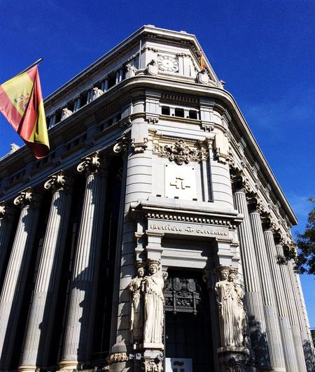 Architecture Built Structure Building Exterior Low Angle View Outdoors History Sky Architectural Column Day No People Travel Destinations Statue Flag Flags In The Wind  Spanish Spain ✈️🇪🇸 Building