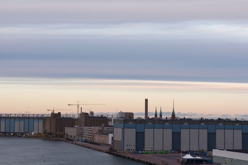 Helsinki sunset Architecture Sky Built Structure Building Exterior Water Sunset Industry Cloud - Sky Mode Of Transportation Transportation No People Building Outdoors High Angle View Business City Factory Container Nature