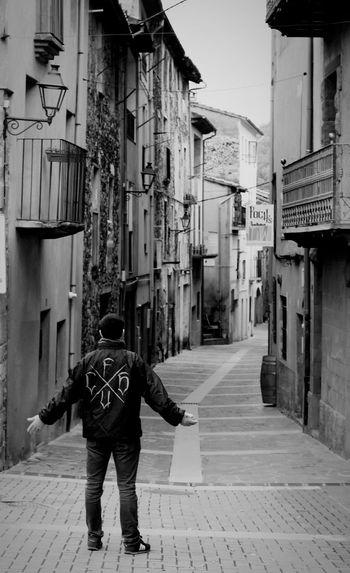 Full length of man on street in city