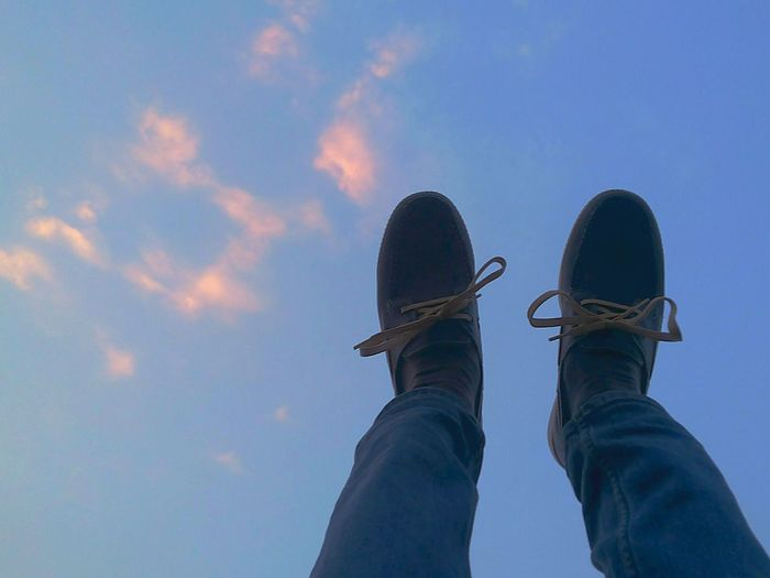Adventure Art And Craft Atmosphere Atmospheric Mood Balance Carefree Cloud - Sky Cloudscape Cloudy Dramatic Sky Jeans Light Low Angle View Moody Sky One Person Outdoors Overcast Recreational Pursuit Shoe Shoes Silhouette Sky Standing Storm Cloud