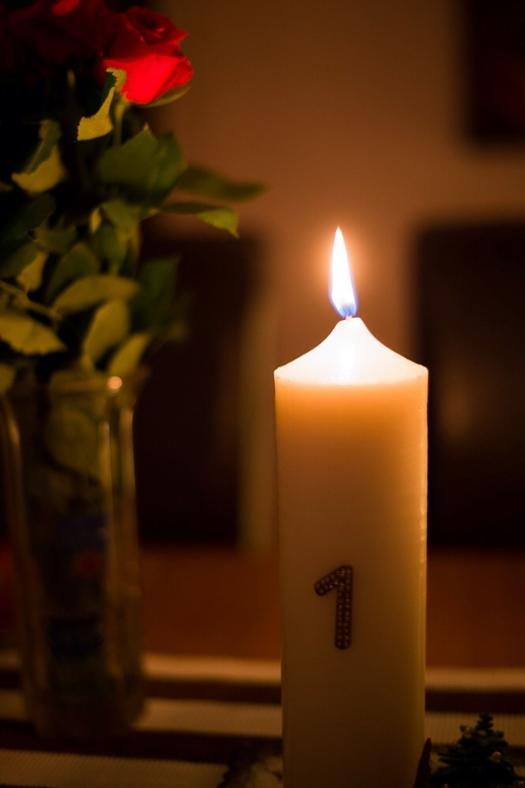 flame, candle, burning, illuminated, indoors, glowing, fire - natural phenomenon, heat - temperature, lit, close-up, candlelight, religion, decoration, lighting equipment, spirituality, night, darkroom, light - natural phenomenon, focus on foreground, selective focus