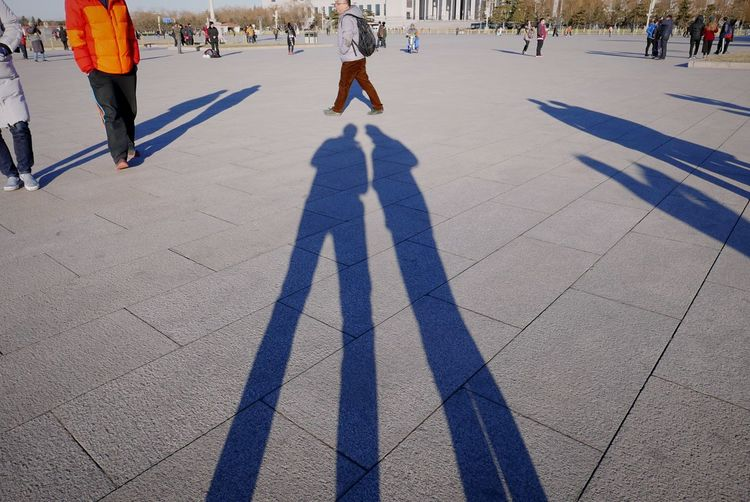 Together, we are going to change the world. Light And Shadow Shadow Shadow-art Street Photography Moment Silhouette Floor Low Angle View Ground Grey Places People Standing Tall High Long Shadows China Two Next Close Silhouettes Of People The City Light