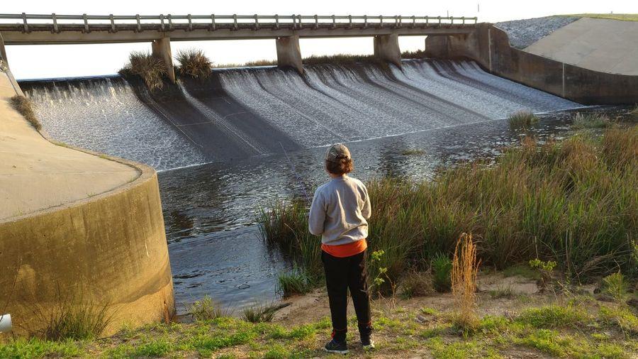 Full length of boy splashing water