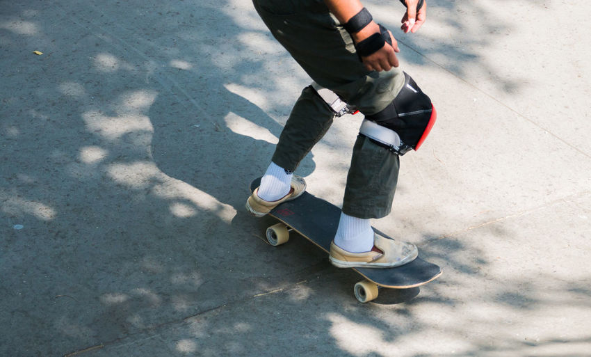 man skateboarding in a skatepark Real People Low Section One Person Lifestyles Day Leisure Activity Shadow Sunlight Human Leg Casual Clothing Human Body Part High Angle View Sport Body Part Shoe Nature Outdoors City Transportation Riding Jeans