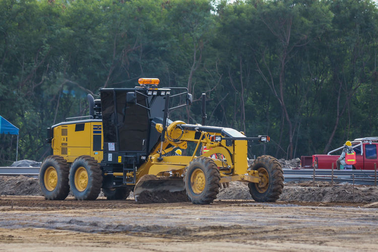 Bulldozer Construction Equipment Construction Industry Construction Machinery Construction Site Construction Vehicle Day Earth Mover Industrial Equipment Industry Land Land Vehicle Machinery Mode Of Transportation Nature Outdoors Plant Road Transportation Tree Working Yellow
