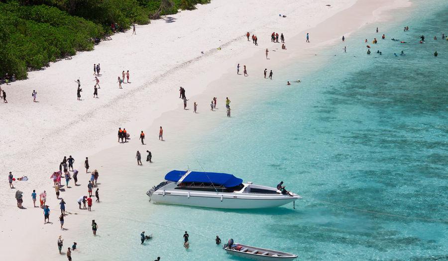 High angle view of people enjoying in sea