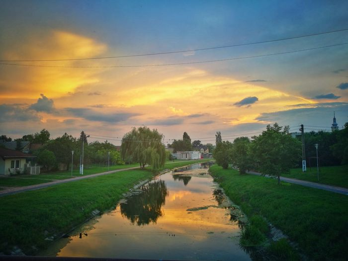 Sky Sunset Water Cloud - Sky Tree Reflection Plant Scenics - Nature Nature Beauty In Nature Architecture Orange Color No People Grass Built Structure Tranquility Canal Building Exterior Outdoors