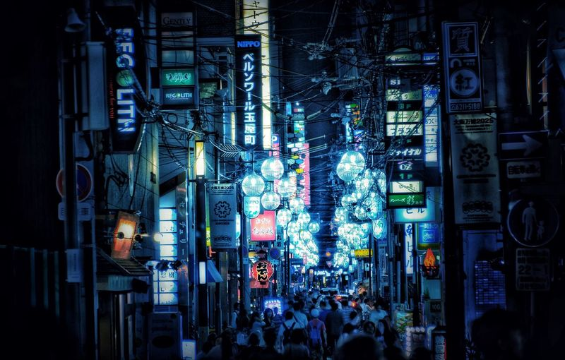 De Runner 🏃City EyeEm Gallery Japan Japan Photography Blue OSAKA Dōtonbori Neon Lights Eyeemphotography Illuminated Built Structure Architecture Night City Building Exterior Real People Crowd Group Of People City Life Lifestyles Building Large Group Of People Advertisement