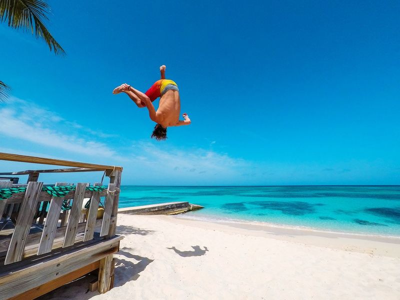 🏃just the regular beach shenanigans🏝️~ Beach Sea Jumping Blue Sand Water Mid-air Vacations Sky Summer Enjoyment Paradise Turquoise Colored Grandturk Turksandcaicos Beauty In Nature Travel Destinations Gopro Parkour Stunts Freerunning Acrobatics  Flips  Go Higher