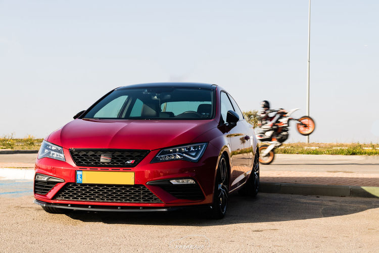 Bright Cars Leon Motorcycle Car Clear Sky Cupra Day Land Vehicle Mode Of Transport Motorcycles Nature No People Outdoors Red Road Seat Sky Stationary Transportation Vehicle Vehicle Seat EyeEmNewHere Mobility In Mega Cities