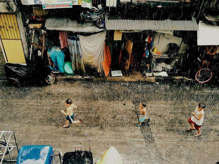 Men in front of building