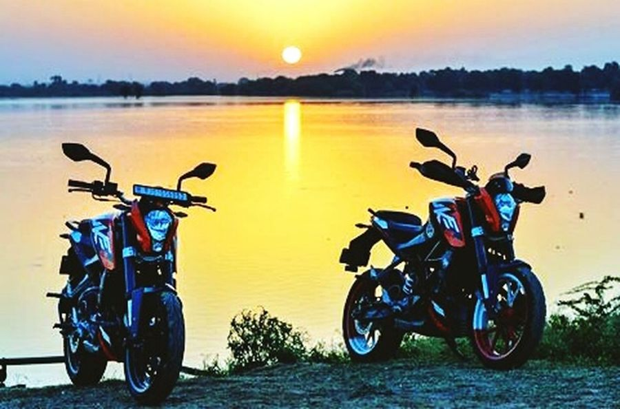Motorcycle Transportation Freedom Stationary Sunset Tranquility Reflection Rural Scene Travel Landscape Outdoors Summer Water People Friendship Vacations Nature Sky Adults Only Adult