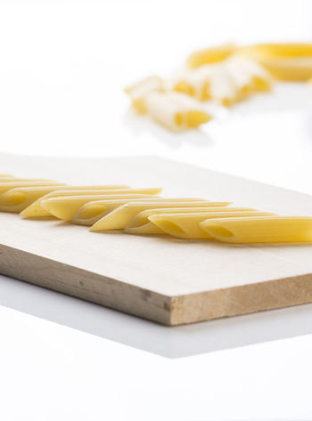Italian Pasta Close-up Food Food And Drink Freshness Healthy Eating Indoors  Italian Food Italy No People Pasta Penne Raw Food Studio Shot White Background Yellow