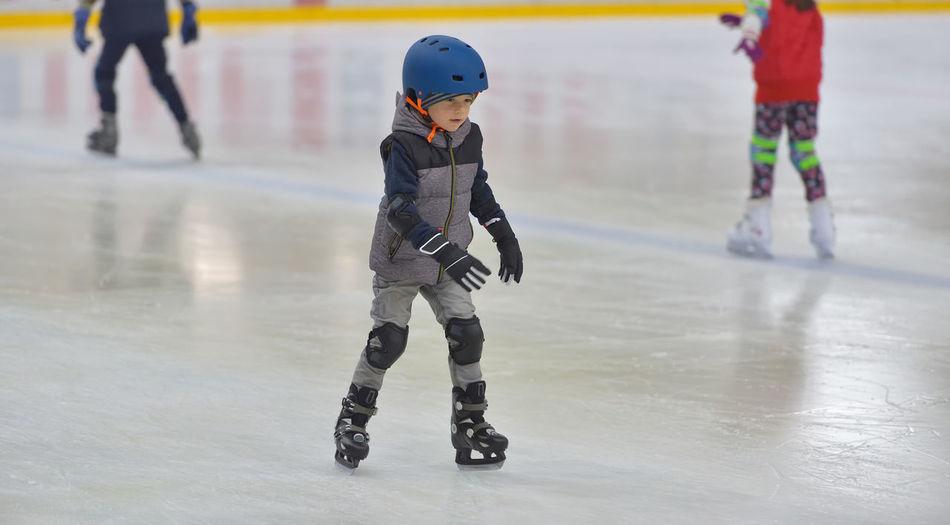 Boy ice skating on rink