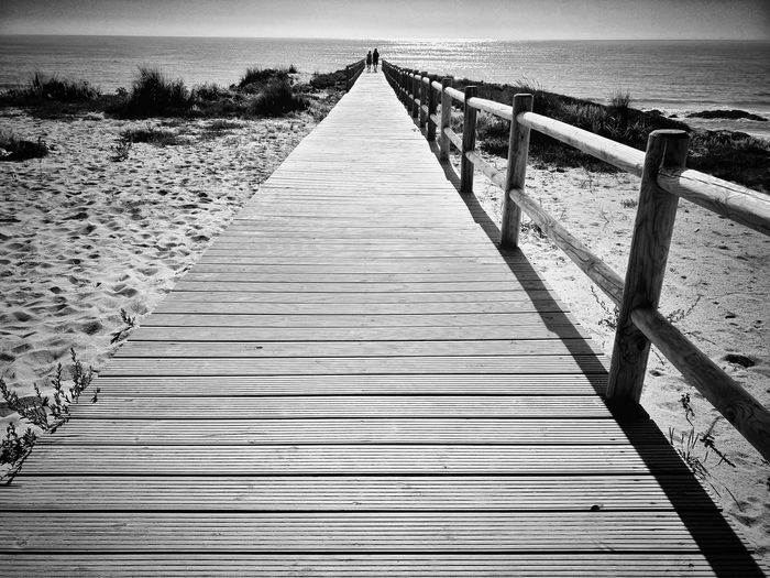 Boardwalk At Beach On Sunny Day