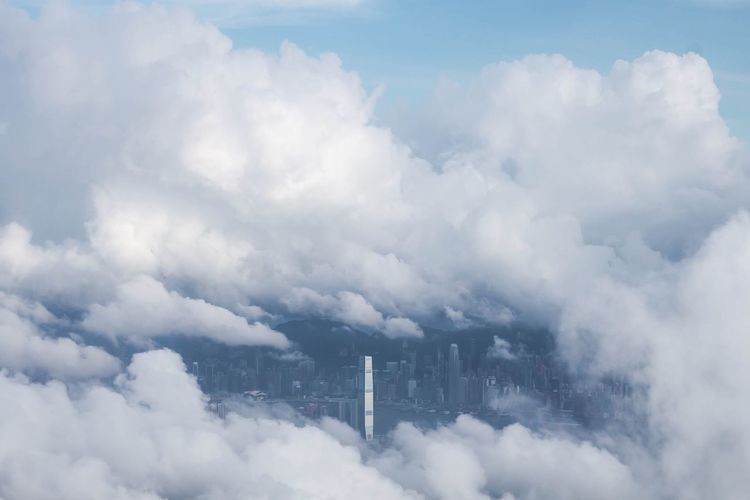 High angle view of cityscape covered with clouds