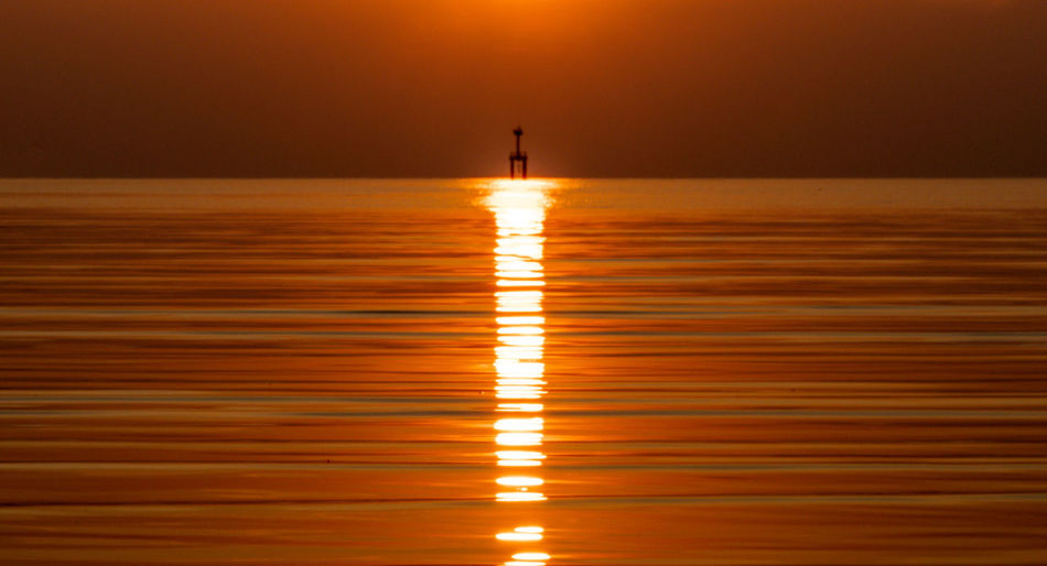 Water Reflection Sunset Sky Sea Orange Color Nature Horizon Scenics - Nature Horizon Over Water Tranquility Silhouette Tranquil Scene Beauty In Nature Sunlight Distant Illuminated Nautical Vessel Idyllic Outdoors