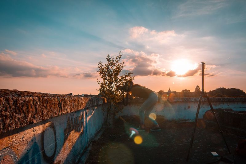 Modelgirl Blonde Wavy Hair Lens Flare Sky Cloud - Sky Sunset Sunlight Outdoors Sun One Person Nature Tree Animal Themes Beauty In Nature Real People Day People Urbex