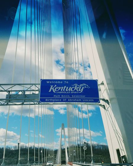 Welcome to my home. 🌺🌺🌺🌺🌺🌺🌺🌺🌺🌺🌺🌺🌺🌺🌺🌺🌺🌺🌺🌺🌺🌺🌺 Sky Blue Suspension Bridge Cloud - Sky Architecture Russell Kentucky Ironton Ohio IMography Galaxy S7 VSCO Exceptional Photographs Leading Lines Welcome To Kentucky Architecture Photography Kentucky  Rosie Peach Photography Ironton Russell Bridge Architectureporn Welcome Sign Welcome Sign