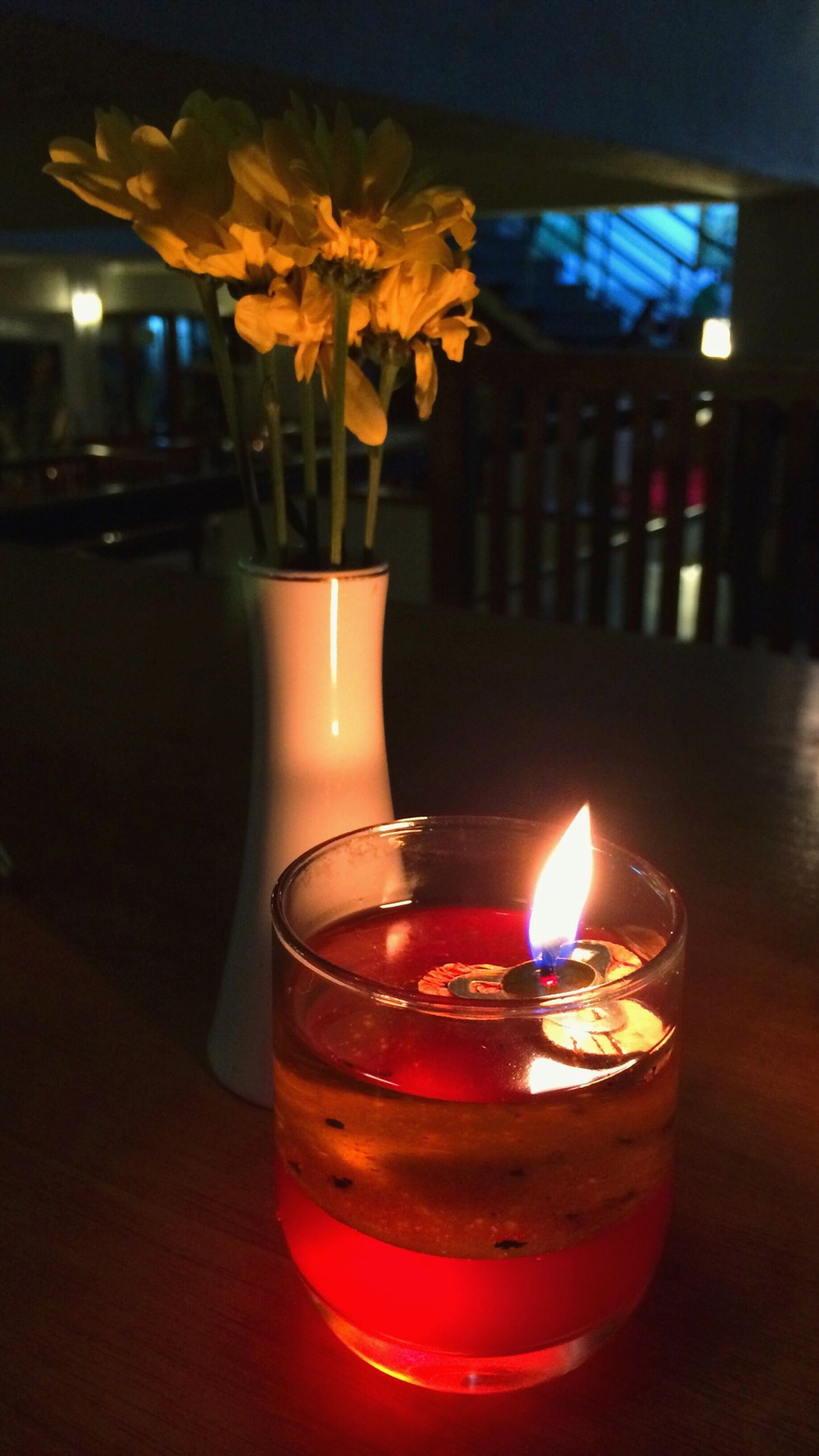 flame, burning, candle, fire - natural phenomenon, indoors, heat - temperature, illuminated, glowing, lit, close-up, candlelight, table, glass - material, focus on foreground, fire, night, dark, flower, tea light, still life