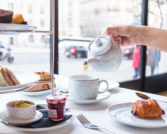 Food And Drink Human Hand Food Cup Coffee Drink Hand Mug One Person Coffee Cup Coffee - Drink Baked Table Indoors  Real People Refreshment Freshness Human Body Part Plate Sweet Food Hot Drink Crockery French Food Breakfast Temptation Tea - Hot Drink Window Teapot