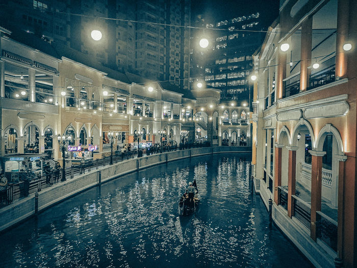 Cruisin' in this man-made canal. Ice Rink Illuminated City Gondola - Traditional Boat Water Lighting Equipment Architecture Building Exterior Built Structure