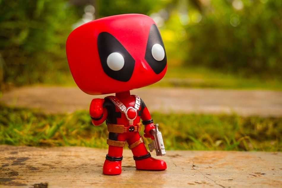 Red Toy Childhood Field Day Focus On Foreground Outdoors Grass No People Scarecrow Toy Car Nature Close-up Funko Marvel Photooftheday Toyphotography Deadpool Sony Funkopop Jakarta INDONESIA Serpong