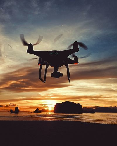 Sunset Sky Sea Flying Cloud - Sky Beach Mid-air Silhouette Drone  Transportation Technology Outdoors Aerospace Industry One Man Only Futuristic Camera - Photographic Equipment Sunset_collection Sunsetporn Beauty In Nature Langkawi Island Sunlight And Shadow Travel Destinations Langkawi Sky Moodoftheday Tanjungrhulangkawi Neon Life Be. Ready.