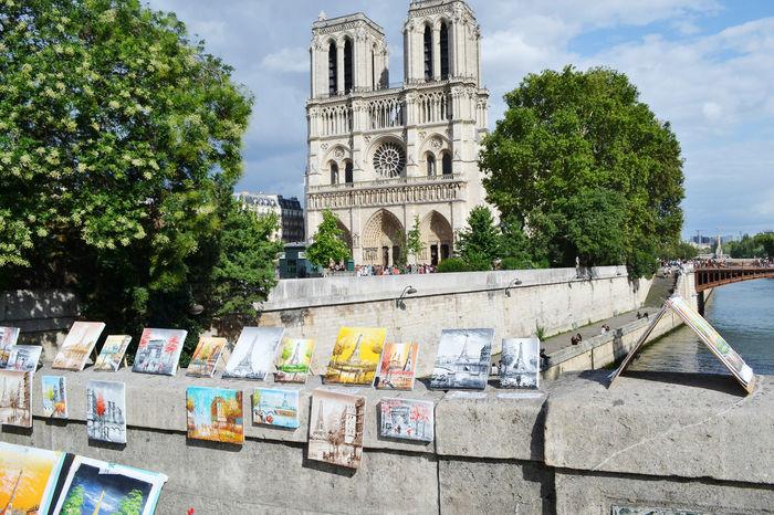 Church France Notre Dame De Paris Notre-Dame De Paris Paris Architecture Art Art Fair Built Structure Fair History Notre Dame Outdoors Painting Religion Street Your Ticket To Europe