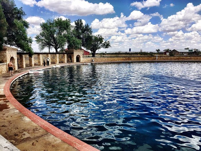 Sommergefühle Balmorhea, TX Water Cloud - Sky Swimming Pool Sky Architecture Built Structure Reflection Tree Outdoors Travel Destinations Day Reflecting Pool Building Exterior Vacations Nature Cooling Off Summertime Spring Fed Westtexasskies
