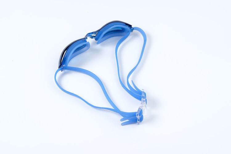 Blue Clean Equipment Glossy Goggle Goggles Rubber Swim Swimming Swimming Goggle White White Background Studio Shot Indoors  Close-up No People Cut Out Copy Space Still Life Single Object Design High Angle View Shape Pattern Two Objects Natural Pattern Abstract Motion White Color Swirl