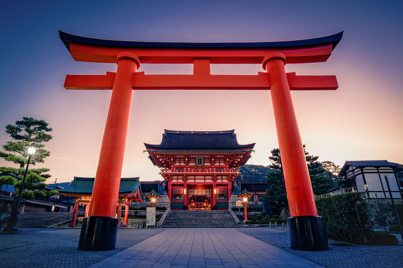 The entrance to Fushimi-Inari Shrine in Kyoto. Japan Japan Photography TORII Tradition Architecture Building Exterior Built Structure Clear Sky Culture Day Nature No People Outdoors Place Of Worship Red Religion Shrine Sky Spirituality Sunset Tourism Travel Travel Destinations Tree An Eye For Travel