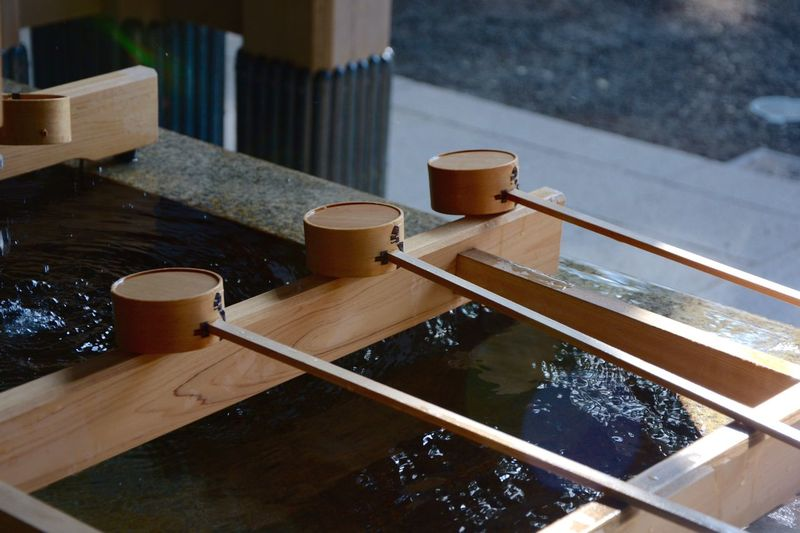 Close-up of traditional water basin with bamboo dippers