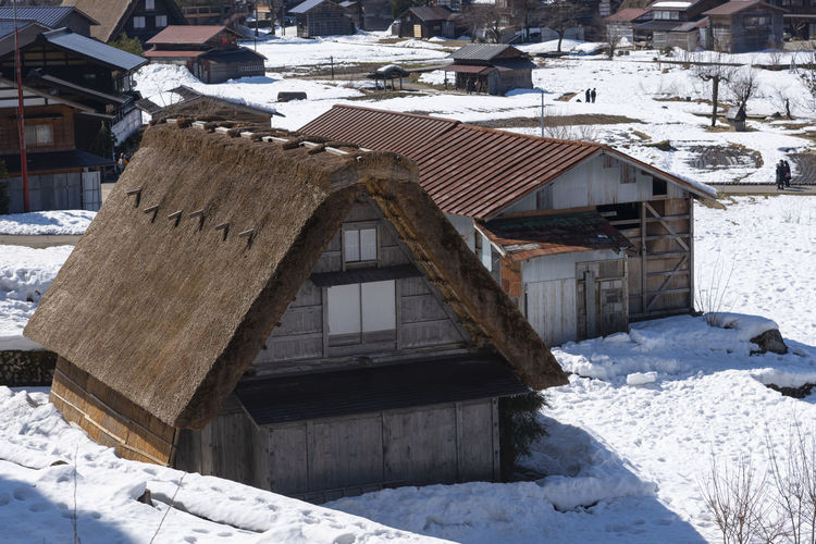 High angle view of snow covered houses and buildings