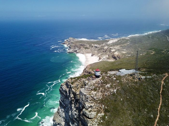 Lighthouse at Cape of Good Hope Cape Of Good Hope Lighthouse Beauty In Nature Blue Cape Of Good Hope Cliff Day High Angle View Horizon Over Water Nature No People Outdoors Rock - Object Rock Formation Scenics Sea Sky Tranquil Scene Tranquility Water