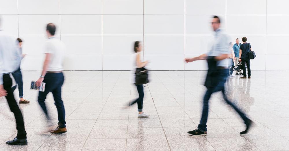 Blurred Motion Of People Walking On Tiled Floor