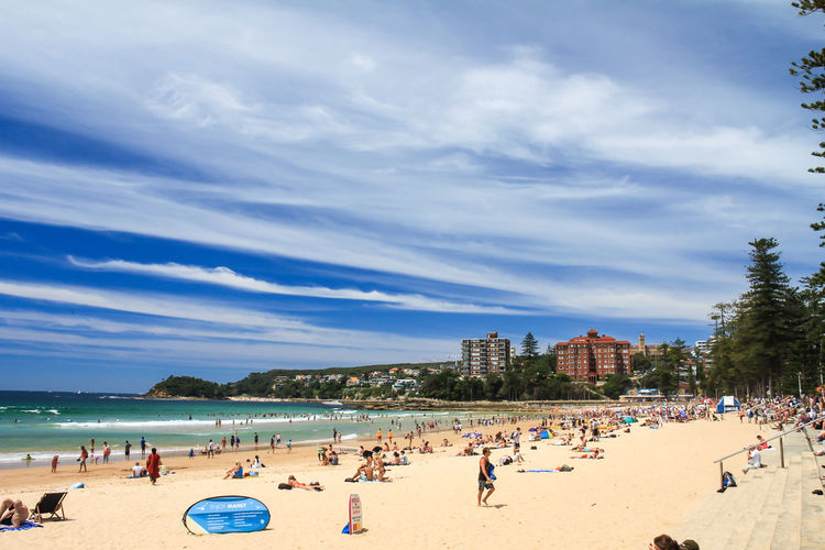 Beach Land Group Of People Water Large Group Of People Sky Crowd Sea Sand Real People Architecture Nature Trip Vacations Holiday Cloud - Sky Day Leisure Activity Built Structure Outdoors